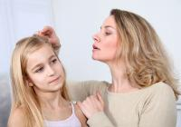 Mother InspectingChild's Scalp and Hair for Lice